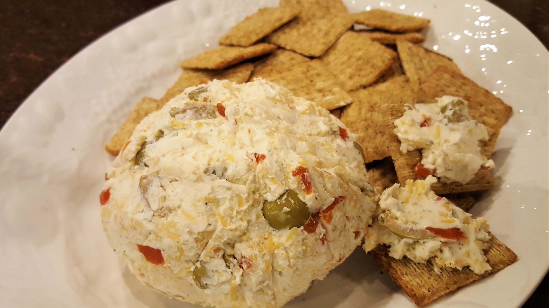 Pimento Olive Cheese Ball ready to serve - Dining in with Danielle
